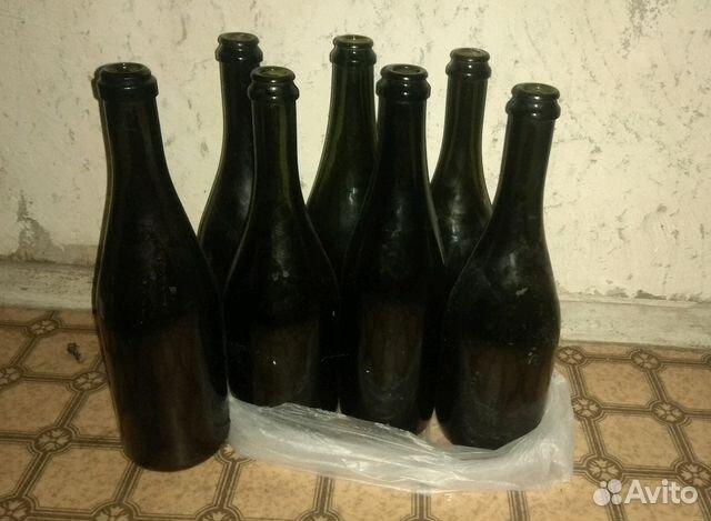 Фотографии на бутылках в железнодорожном